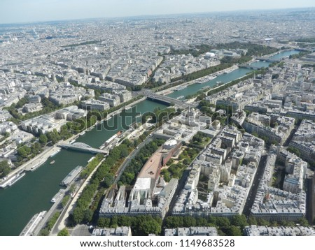 city view from eiffel tower, paris, france, 8th august 2017: beautufuk city skyline view with water canals from top floor of eiffel tower