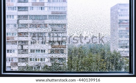 City view from the rainy window. Raindrops on the window