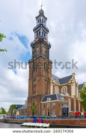 City view of Amsterdam canal and church Westerkerk, boats and bicycles, Holland, Netherlands.