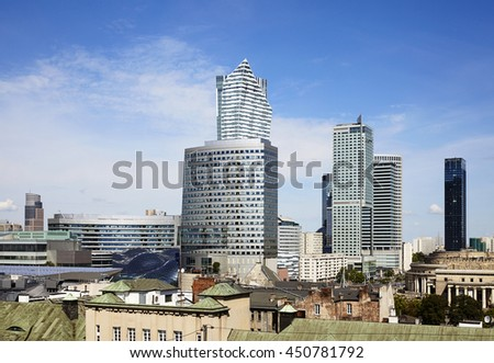 City view of Warsaw business district at sunny day. Few skyscrapers and blue sky.