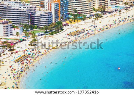 City with hotels and beach with people under the sun (Costa Brava - Spain) - stock photo
