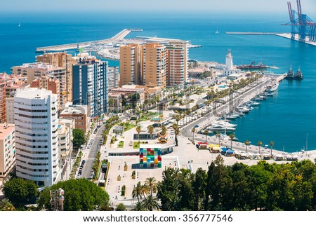 Cityscape aerial view of Malaga, Spain. Lighthouse and marina.