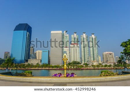 cityscape at benjakitti public park on midtown bangkok thailand with high rise building of residential and business center.