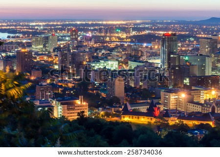 Cityscape at East of Montreal view from mountain of Mount-Royal at dusk. - stock photo