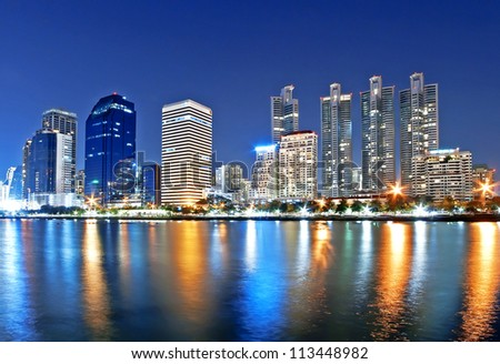 Cityscape at night time, Benjakitti park, Bangkok, Thailand - stock photo