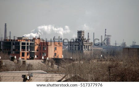 Cityscape, buildings, homes and smokestack factories