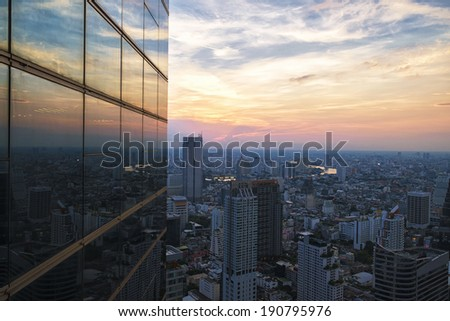 Cityscape in middle of Bangkok reflect with mirro - stock photo