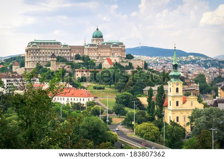Cityscape including castle and church in the beautiful city of Budapest in summertime. - stock photo