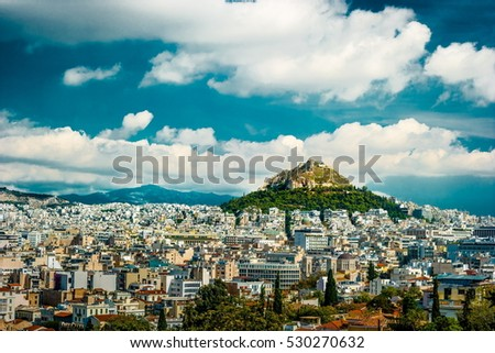 Cityscape of Athens and Lycabettus Hill in the background, Athens, Greece.