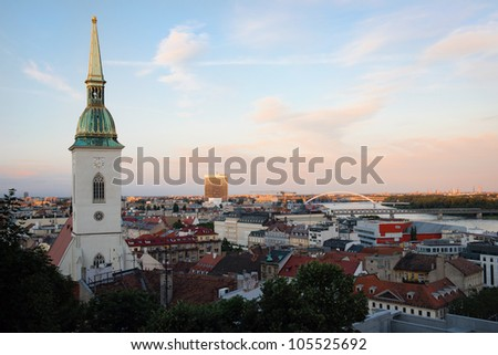 Cityscape of Bratislava at dusk with St. Martin's Cathedral in front, Slovakia