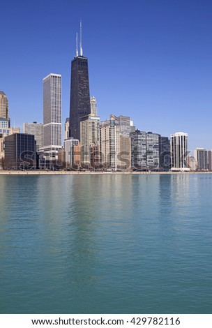Cityscape of Chicago with reflection on the lake - stock photo