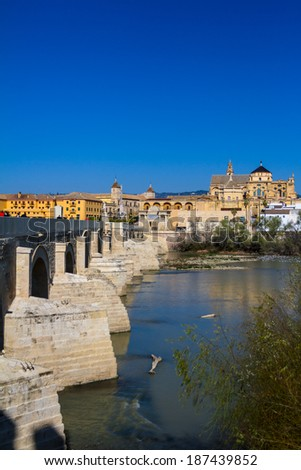 Cityscape of Cordoba with roman bridge and Mezquita, Andalusia, Spain - stock photo