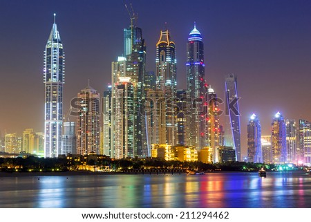 Cityscape of Dubai at night, United Arab Emirates - stock photo