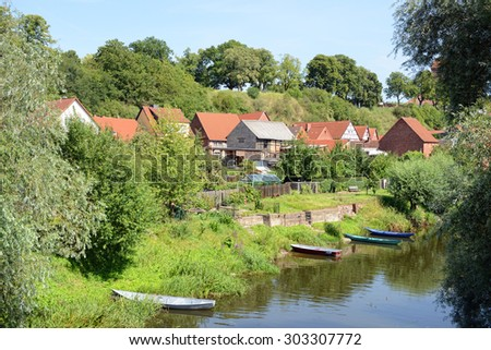 Cityscape of Havelberg (Germany, Saxony-Anhalt) with Havel River and boat.