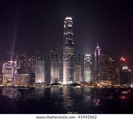 Cityscape of Hong Long skyscraper with famous ray show in the night, Asia.
