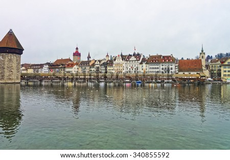 Cityscape of Lucerne old town, with the famous Chapel Bridge (Kapellbrucke), the Reuss river and historical buildings. Switzerland. Europe. - stock photo
