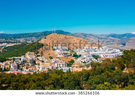 Cityscape of Malaga, Spain. White residential houses on hill. Sunny summer day - stock photo