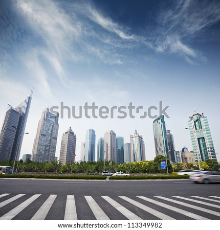 cityscape of modern city,shanghai with blue sky - stock photo