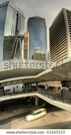 Cityscape of modern city with business skyscrapers and flyover in and one car on road in Hong Kong, China. - stock photo