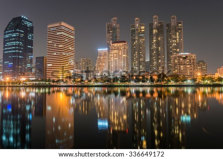 Cityscape of Modern town in Bangkok with reflection on water, Thailand