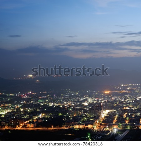 Cityscape of night scenery with houses and buildings under blue sky in Puli township, Nantou County, Taiwan, Asia.