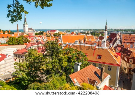 Cityscape of old town Tallinn with bright roofs in sunlight, Estonia - stock photo