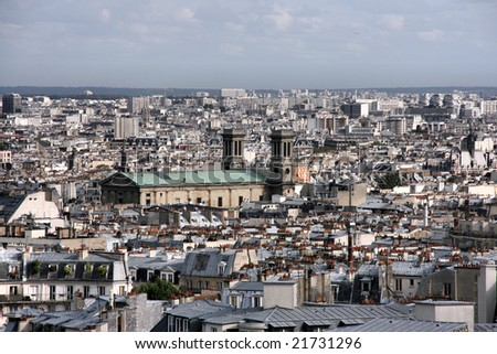 Cityscape of Paris seen from Montmartre hill. The prominent building is Saint Vincent de Paul church.