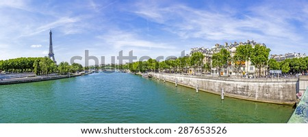 Cityscape of Paris with view at Eiffel tower - the Seine river and residential buildings - stock photo