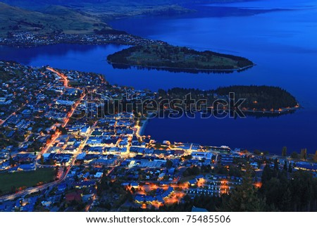 Cityscape of queenstown with lake Wakatipu from top at dusk. - stock photo