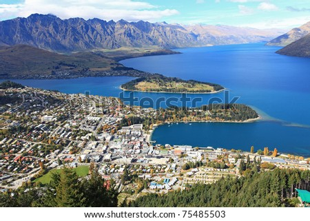 Cityscape of queenstown with lake Wakatipu from top at noon. - stock photo