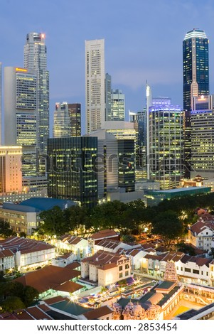 Cityscape of Singapore at dusk showing the financial district and shophouses in the foreground