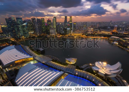 Cityscape of Singapore city skyline at sunset in Marina Bay
