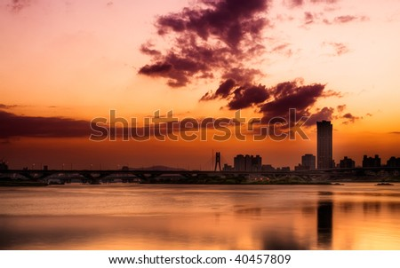 Cityscape of sunset with river and clouds in  Taipei.