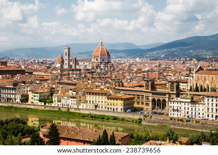 Cityscape panorama of Arno river, towers and cathedrals of Florence - stock photo