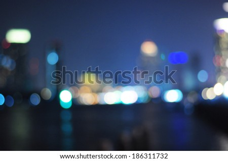 Cityscape river view in twilight time, Blurred Photo bokeh - stock photo