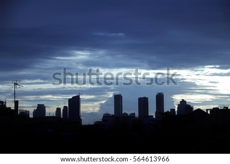 Cityscape silhouette over the sky before sunset