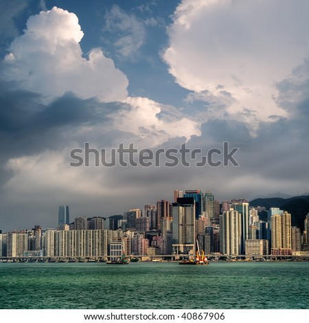 Cityscape with blue sky and white clouds near ocean in Hong Kong. - stock photo