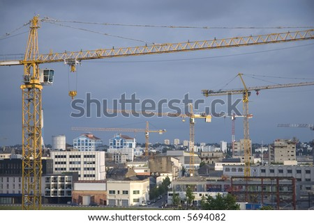 Cityscape with construction cranes in Nantes, France. - stock photo
