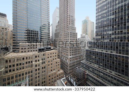 Cityscape with many high buildings at the autumn day. - stock photo