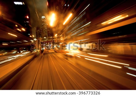 Cityscape with motion blurred reflections of a passing vehicle. Evening in the city of abstraction. - stock photo