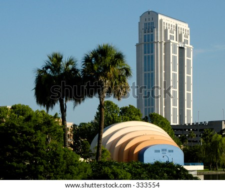 Cityscape with office building and amphitheater - stock photo