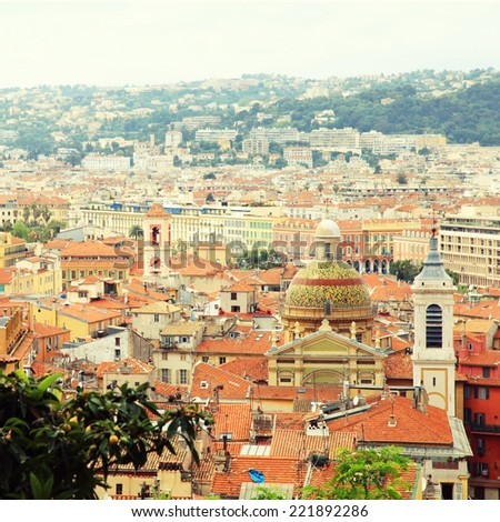 Cityscape with red tile roofs of Nice(Cote d'Azur, France), view from above. Instagram effect, square toned image - stock photo