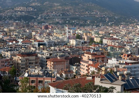 Cityscape with solar thermal collectors for water heating on the roofs of Alanya, Turkey - stock photo