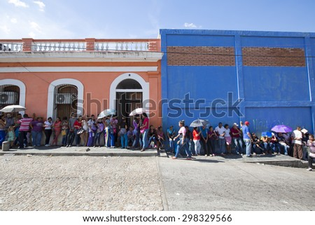CIUDAD BOLIVAR, VENEZUELA, APRIL 9: Unidentified group of people waiting in line at a public supermarket in Ciudad Bolivar. With high inflation, rationing is required in Venezuela in 2015 . - stock photo