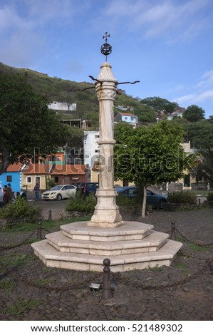 CIUDAD VELHA, SANTIAGO ISLAND, CAPE VERDE - SEPTEMBER 03, 2015: Picota, post to chain the slaves, now converted into central monument of the town