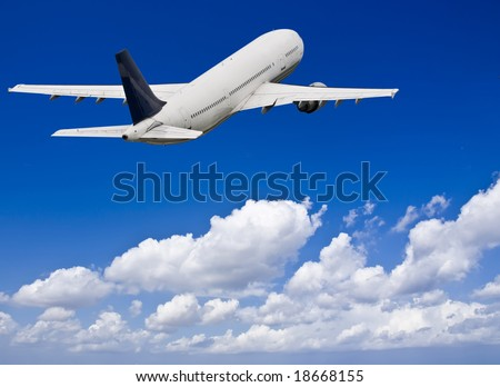 Civil aircraft flying into deep blue skies with some cloud - stock photo