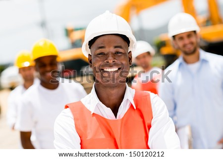 Civil engineer at a building site wearing a helmet  - stock photo