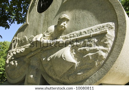 civil war monument and crawling soldier - stock photo