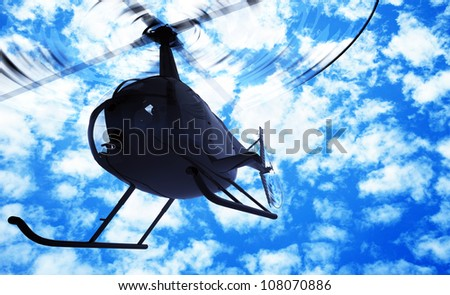 Civilian helicopter in the sky. - stock photo