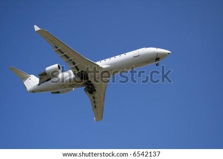 Civilian jet plane on landing - stock photo